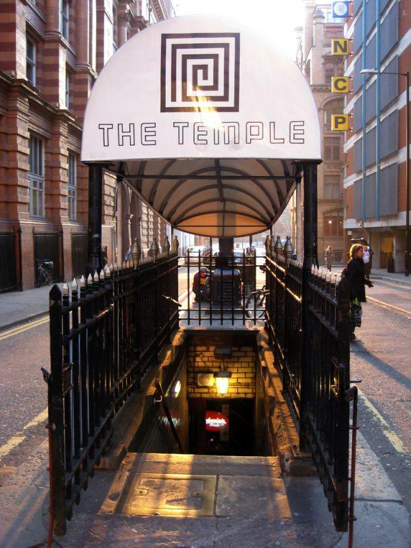 temple of convenience entrance Deptford Project Recycles Old London Train to Create Modern Cafe
