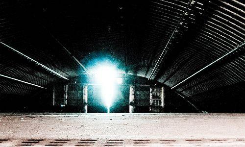 Inside one of the vast empty hangars (image by light arted)