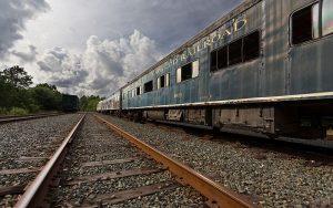 Photograph of a retired Cape Cod Railroad coach stored in Massachusetts