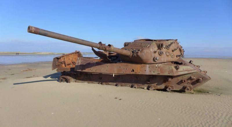 "An abandoned tank slowly rusts away at the ""Elephant Beach"""