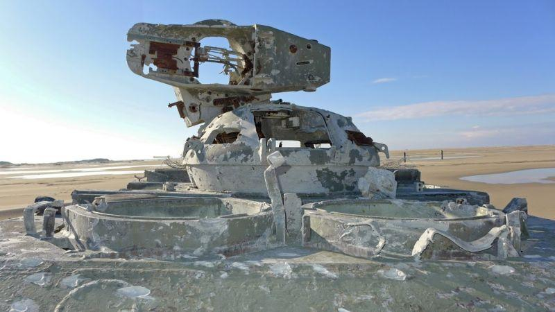 "An abandoned combat vehicle lies on the ""Elephant Beach"" somewhere in western Europe"