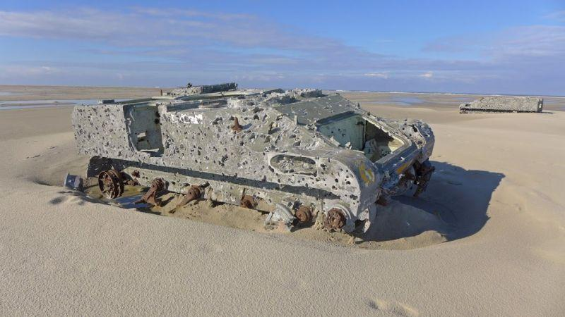 """A derelict infantry fighting vehicle lies in the sand of the """"Elephant Beach"""""""
