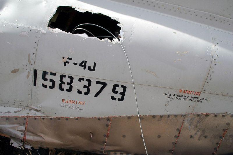 Visible serial number of the twisted rear fuselage of F-4 Phantom 158379