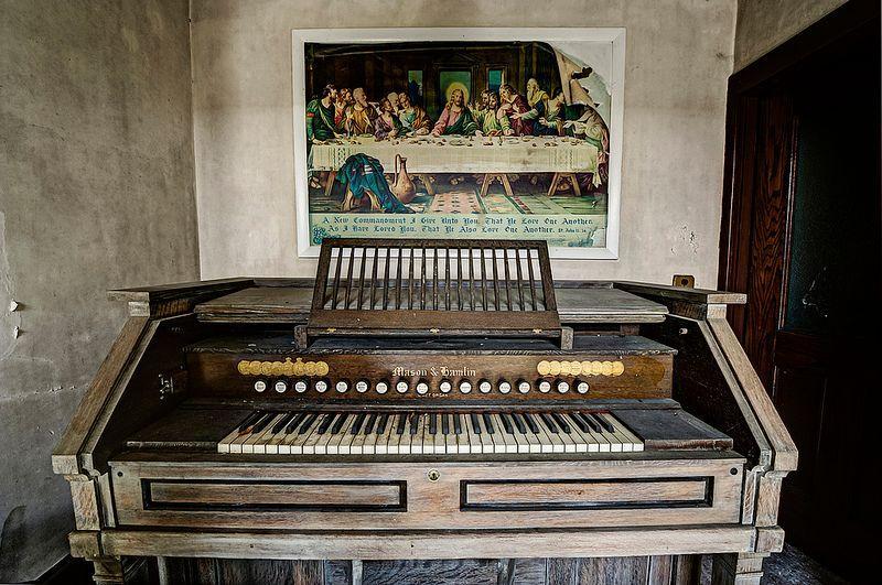 An organ left behind inside a derelict masonic temple