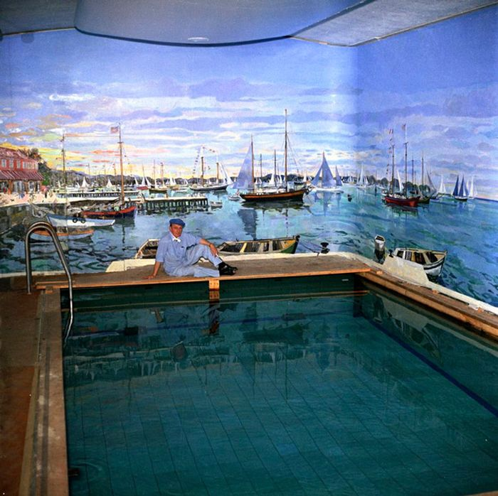 Bernard Lamotte paints a mural on the walls of the old White House swimming pool, 1962