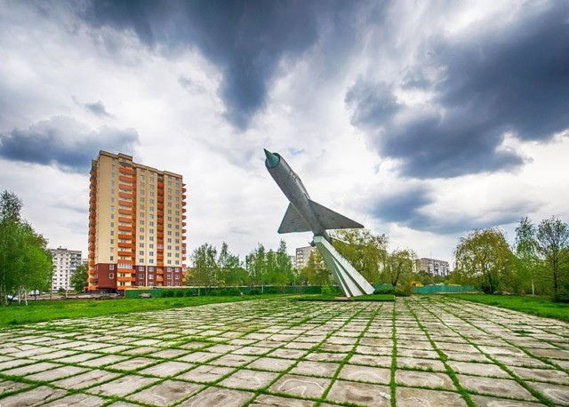 Mikoyan-Gurevich MiG-21 Points Skyward Amid a Ukrainian Housing Estate